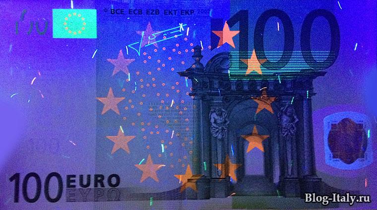 Вид на настоящую купюру 100 евро через детектор банкнот