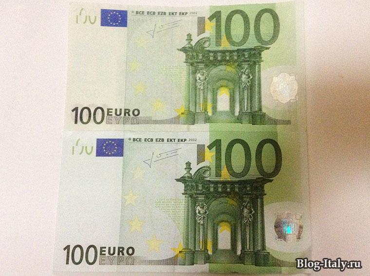 Банкнота 100 евро, фальшивая и настоящая